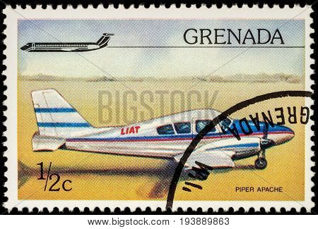 Moscow Russia - July 04 2017: A stamp printed in Grenada shows American small aircraft Piper Apache series circa 1976