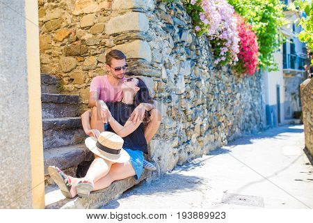 Young tourist couple traveling on holidays outdoors in italian vacation.