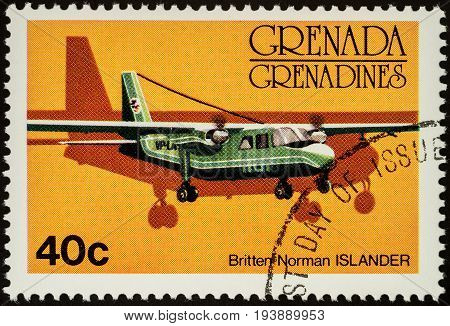 Moscow Russia - July 04 2017: A stamp printed in Grenada shows small British aircraft Britten Norman Islander series circa 1976