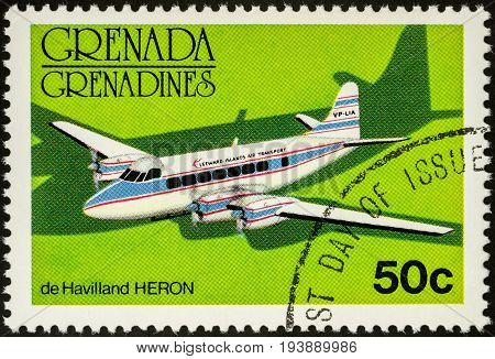 Moscow Russia - July 04 2017: A stamp printed in Grenada shows old small passenger aircraft De Havilland HERON series circa 1976
