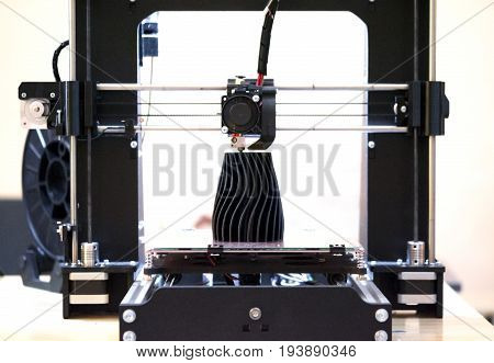The process of working 3D printer and creating a three-dimensional object. Progressive modern additive technology. 4ht industrial revolution.