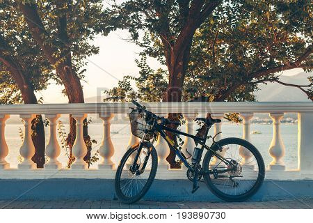 Mountain Bicycle Is Parked Near White Fence Health Leisure Urban Lifestyle Vehicle