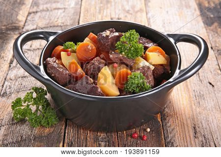 beef stew with vegetable on pot