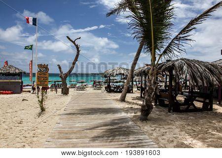 ST.MAARTEN - AUGUST 2: Bikini beachy entrance on Orient Bay (Baie Orientale) area  in Sint Maarten, seen in St.Maarten on August 2, 2015