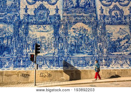 PORTO, PORTUGAL - MAY 7, 2017:  Portuguese azulejo tile on one of the streets of the Old Town. In 1996, UNESCO recognised Old Town of Porto as a World Heritage Site.