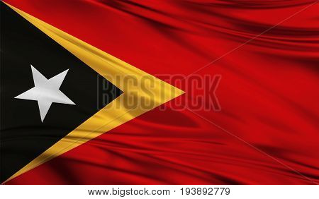Realistic flag of East Timor on the wavy surface of fabric. This flag can be used in design