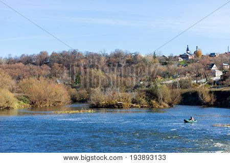 Rural areas in Russia. In the distance the fisher catches fish on the river