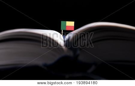 Benin Flag In The Middle Of The Book. Knowledge And Education Concept.