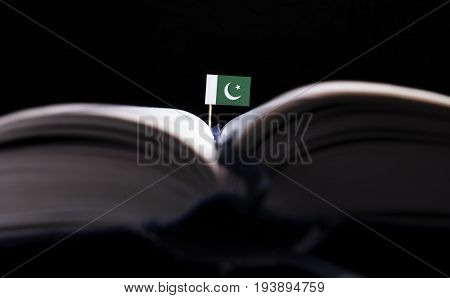 Pakistani Flag In The Middle Of The Book. Knowledge And Education Concept.