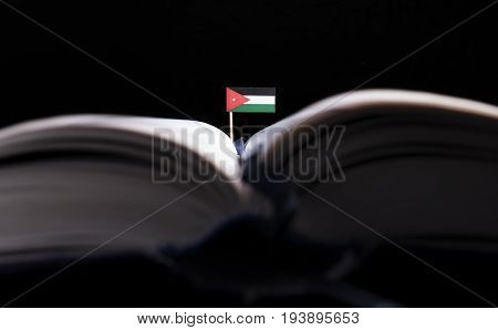 Jordanian Flag In The Middle Of The Book. Knowledge And Education Concept.