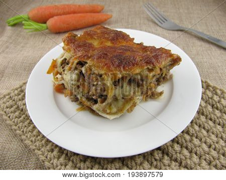 Freshly baked lasagne with minced meat and carrot