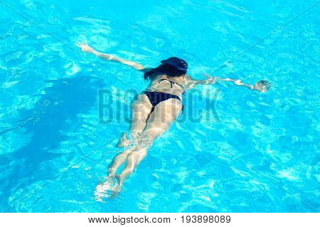 Young Woman Swimming Underwater in the Swimming Pool. Summer Vacation