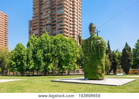 SANTIAGO CHILE - NOVEMBER 11 2016: The Statue of pope John Paul II. The monument is situated in the puplic park of Las Condes district and made of green plants.