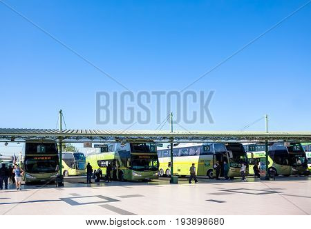 SANTIAGO CHILE - OCTOBER 26 2016: People and buses at the platforms at Alameda station. This is the largest and primary bus terminal of the city.