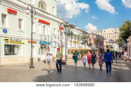 MOSCOW - AUGUST 7 2016: People wallking on Klimentovsky lane on clear day. This area was reconstructed and became pedestrian in 2014.