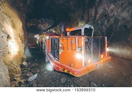 Gold mining deep underground. Golden ore extraction.