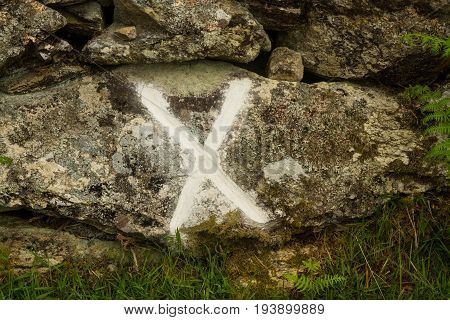 After a powder oil explosion 1869 wheel and harness found by this wall X marks this Cwm y Glo Llanberis Wales United Kingdom.