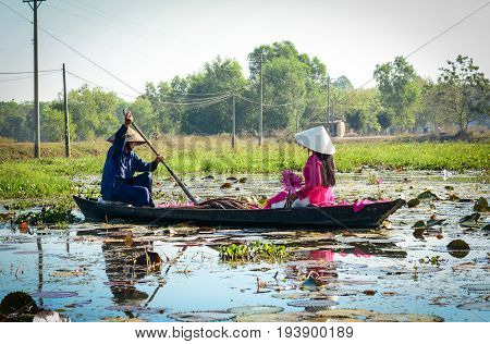 People Rowing Boat On The Lotus Lake