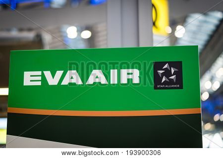 Bangkok, Thailand - May 2016: Eva Air logo signboard at check-in counter in  Suvarnabhumi Airport, Bangkok, Thailand.  Eva Air is a Taiwanese international airline based at Taiwan Taoyuan International Airport near Taipei, Taiwan, operating passenger and