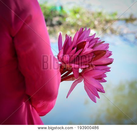 Asian Woman In Traditional Dress With Flowers