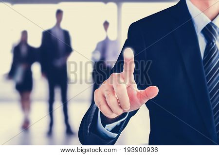 Businessman hand pointing on blank virtual screen modern business background concept - can be used for montage your text or pictures at the finger