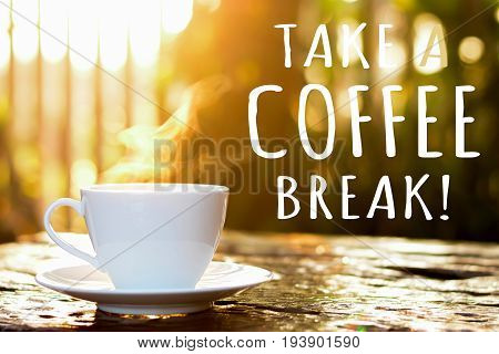 TAKE A COFFEE BREAK text with coffee cup in blur bokeh of morning sunlight background
