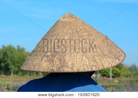 Old Vietnamese Woman With A Conical Hat