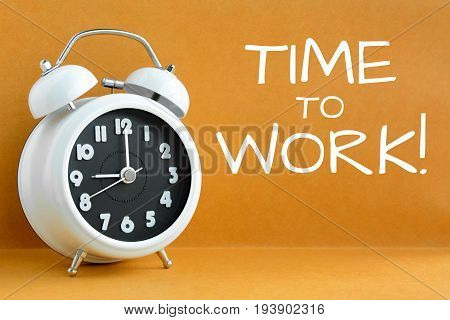 TIME to WORK text on retro brown background with alarm clock showing 9 o'clock