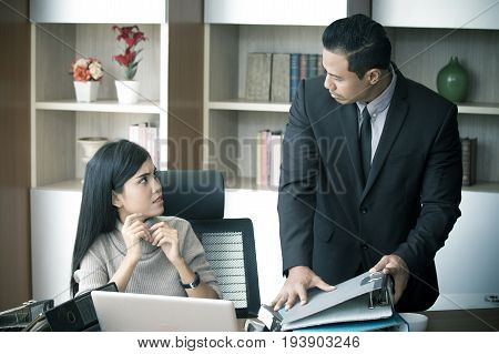 Unfair Boss Giving Assistant Woman A Lot Of Work At Ofiice Place.