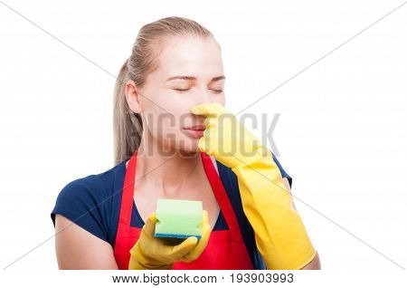 Housewife Plugging Her Nose Because Of Bad Smell