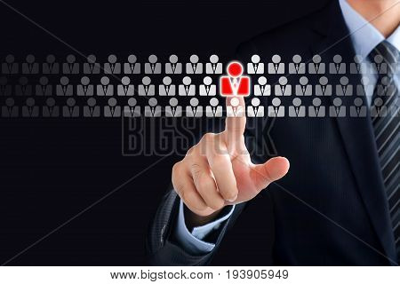 Businessman hand touching red human icon on virtual screen - stand out from the crowd HR and HRM concepts