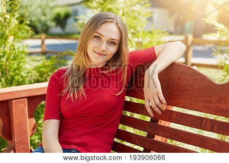 Horizontal Portrait Of Restful Young Attractive Woman With Long Blonde Hair Having Appealing Appeara