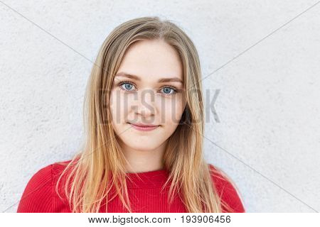 Close Up Portrait Of Pretty Blonde Woman With Blue Alluring Eyes, Freckled Face With Pure Skin Looki