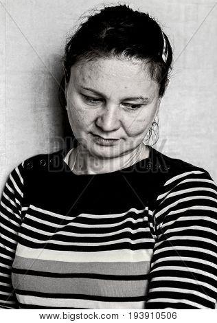 Sad mature woman portrait