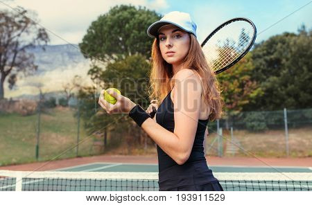 Beautiful Sportswoman With Racket At The Tennis Court