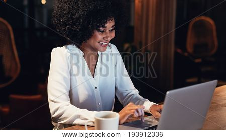 Happy Young Woman Working Late In Office