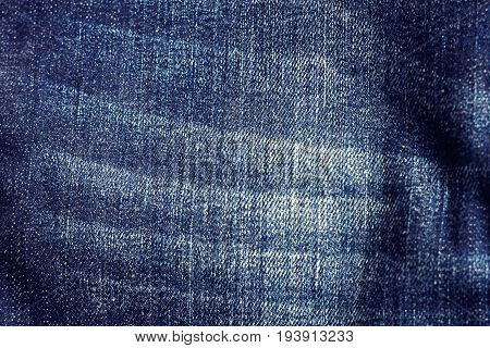 Denim blue jeans texture with space for text Indigo plain surface Indigo classic vintage Close-up of details of a pair of jeans trousers Fabric Background