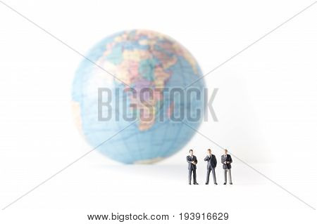 Miniature Model Of Businessman Standing Together And The World Background, Investor Concept, Isolate