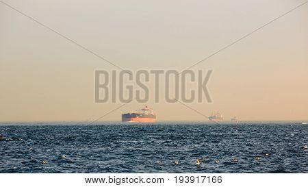 Large cargo container ship passing through Bosphorus, Istanbul, Turkey