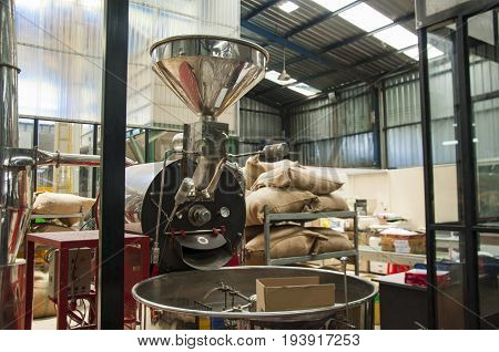 Bags in the warehouse on the racks. Coffee arabica rice.