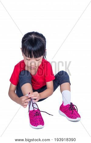 Asian Chinese Little Girl Tying Her Shoes