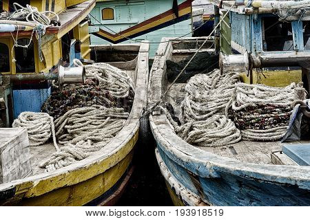 Winches and coiled ropes on old woden fishing boats