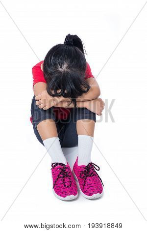 Asian Chinese Little Girl Sitting With Head Down