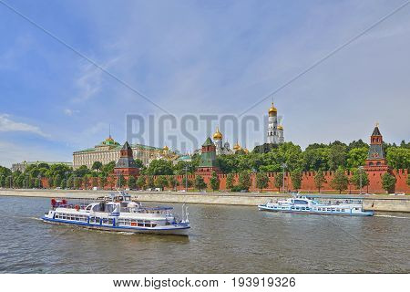 Moscow, Jun 29, 2017: Panoramic view on Moscow Red Square, Kremlin towers, Kremlin Palace, Ivan bell tower church, Moscow river. Excursion river travel cruise boats ships. Famous Moscow Red Square tours vacations