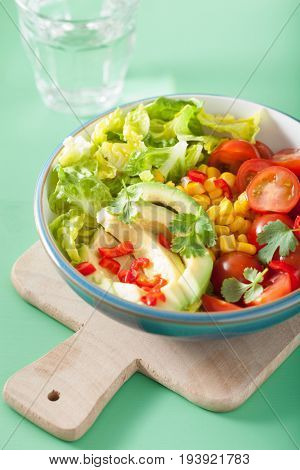 healthy vegan avocado salad with tomatoes and sweetcorn