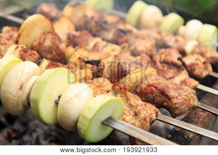 Meat And Onions On Skewers,  Zucchini And Mushrooms On Skewers Are Grilling On Charcoal