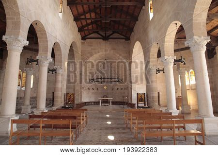TABGHA, ISRAEL - AUGUST 30, 2015: Interior of Multiplication Church the place of pilgrimage of christians from all over the world near the sea of Galilee and Capernaum Tabgha Israel.