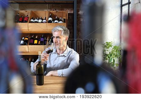 French wine. Man drinking wine in a restaurant