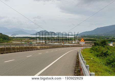 Rural Road With Mountain Background