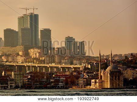 Ortakoy mosque under bosphorus bridge in istanbul, turkey. Bosphorus bridge between asia and europe